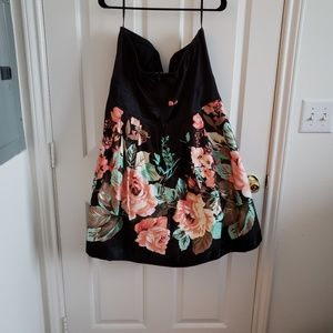 Strapless black dress with flower detail.
